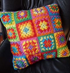 crocheted granny square pillow