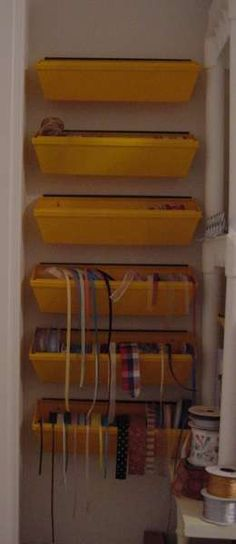 This is only one way that I have ribbon stored. They are drywall putty trays from the Dollar store.