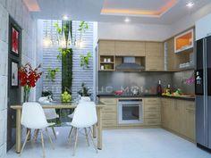 Thiết kế nhà mặt tiền 3m với phòng bếp khá thoáng nhờ có sự góp mặt của giếng trời, mảng kiến trúc xanh hiếm hoi đem lại sự bình yên, trong lành. Bếp và bàn ăn được thiết kế liền kề tăng sự tiện lợi và cơi nới không gian. Hệ thống ánh sáng vàng phân bổ đều khắp không gian tạo sự ấm cúng và giúp thành viên muốn ở lại nơi này lâu hơn. Living Room Partition Design, Room Partition Designs, Small Living Room Design, Small House Design, Outdoor Kitchen Cabinets, Modern Contemporary Homes, Small Dining, Kitchen Sets, Modern Kitchen Design