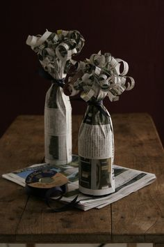 newspaper covered bottles with curly bows
