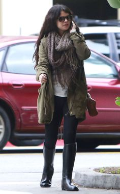 Selena Gomez keeps warm with an army coat and fringed scarf in Burbank. http://www.eonline.com/photos/6415/celebrity-street-style/242718