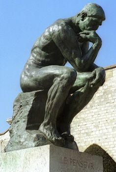 Rodin's Thinker...  every muscle tensed working on ideas.  Rodin said this sculpture was of himself.
