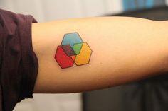 Hakishi Orishima - ink   interlocking hexagons tattoo   primary & secondary colors, clean & simple