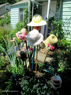 Hats as a garden accent ~ Deborah's Garden in Oregon www.facebook.com/OurFairfieldHomeAndGarden