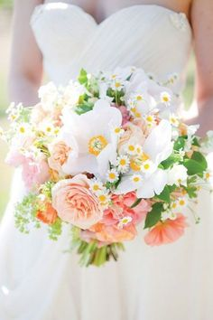 Love these spring colors with coral bridesmaids dresses.
