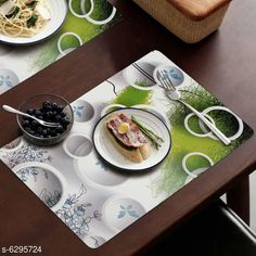 Table Runner Classy Dining Table Place Mats  Material: PVC Pack: Pack Of 6 Pattern: Printed length: 44 cm breadth: 29 cm height: 1 cm Country of Origin: India Sizes Available: Free Size   Catalog Rating: ★4.1 (2678)  Catalog Name: Classy Dining Table Place Mats CatalogID_999879 C129-SC1127 Code: 981-6295724-393