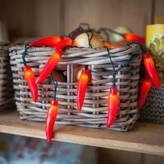 20 Red Chilli Pepper Fairy Lights Tickle your taste buds with these #chillipepper #fairylights. Get inspired by Nigella's kitchen pantry and drape or bunch these 20 chilli's around your home with ease!