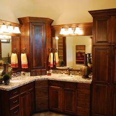 Corner vanity, double sinks, dark cabinets, light granite, CF Olsen Designs