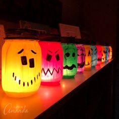 These colorful Halloween luminaries are made from painted mason jars and will light up your sidewalk or window this Halloween! These colorful Halloween luminaries are made from painted mason jars and will light up your sidewalk or window this Halloween! Easy Halloween Decorations, Halloween Crafts For Kids, Halloween Party Decor, Scary Halloween, Halloween Snacks, Diy Halloween Luminaries, Halloween Camping, Halloween Lanterns, Cheap Halloween