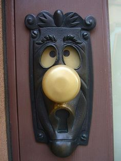 """Weird And Wonderful Door Handles:   """"Finally, here's one for the inner child in you. Remember the Walt Disney film, Alice In Wonderland? Of course you do! Well here's the character The Door Knob serving its true purpose. The eyes even move when you turn the knob, providing the opportunity to release the child inside you.""""  Photo courtesy of Sfgamchick"""