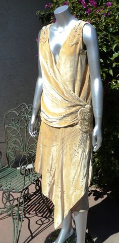 1920s Silk Velvet Beaded Dress with Pearls and rhinestones 3D flower Drop waist Art Deco Fully restored. $1,500.00, via Etsy.