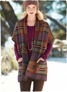 Effortless luxury, our double-faced blanket vest is patterned with large-scale kilim graphics in warm, heathered hues of plum, terra cotta, red and shale green. Jacquard knit of sumptuously soft baby alpaca (70%) and wool (30%), with a shawl collar, drop shoulders and patch pockets.