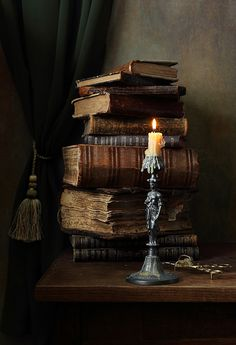 Piles of old, dusty books, only to be read by the light of a sole candle.
