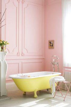 Pastel pink walls and yellow tubs