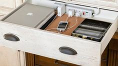 Take an empty dresser drawer and install a surge protector to create a valet that's hidden.