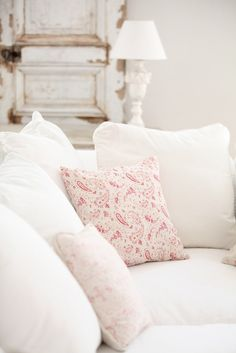 white settee with palest raspberry pink and peeling robin's egg paint