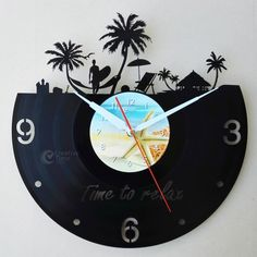 """Uniquely Designed Wall Clock made of used vinyl.  The clock is handcrafted from used vinyl in size of 12""""or 30 cm. Each item has been carefully designed, cut out or painted in variety of choices.  The"""