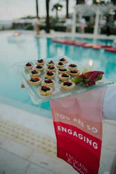 Branded towels were draped over the waiters' arms during the pool party.  Photo: Carla Ten Eyck