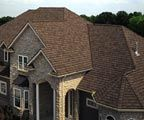 Brown shingles with Sand colored rock/brick