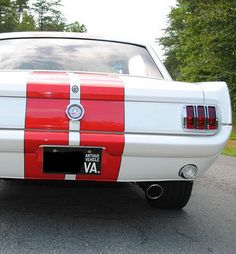 Ford Mustang Coupe in white with red racing stripe for good measure.