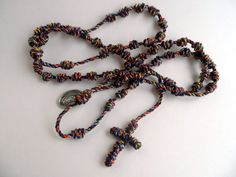 Multi Colored Knotted Cord Rosary with Our Lady of Guadalupe and Santo Nino de Atocha Medal attached, by georgiegirl83, $15.00