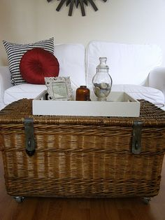 antique wicker trunk - wheels added for versatility as a coffee table