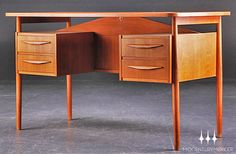 This mid-century desk would make me want to work even more...well, almost.