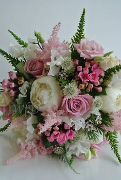 Natural brides bouquet, white peony, waxflower, astilbe, roses.