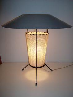 1950′s atomic table lamp, wrought iron tripod legs, fiberglass torso, unusual grey metal top. Via thefabulousfind.ca