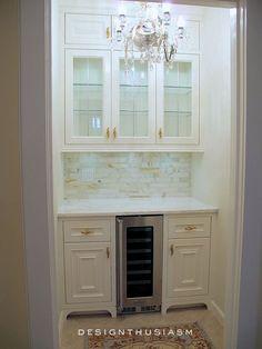 Butler's Pantry. Built-in Bar. Wine Fridge. Glass Front Cabinets. Marble Backsplash. Chandelier.