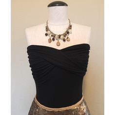 WHBM Strapless (Black) Top sz XS NWOT White House Black Market Strapless (Black) Top sz XS NWOT▪️It has ruche detailing across the bust and is fitted. It could fit a size XS/S. The necklace is NOT included, sold separately.                                                                   NO TRADES NO PAYPAL White House Black Market Tops