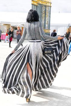 Leigh Lezark goes bold with black and white stripes.Stripes In Streetstyle not sure I like exact patterns but like the flowing skirt and pattern contrasting idea