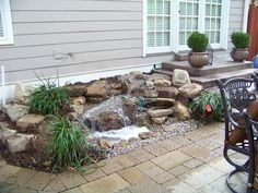 Elite Cascading Falls:  Small Kit - Along side this patio the homeowner has a 5-6ft Pond-Less stream that adds just the right amount of water for quaint sounds, night time interest and bird watching from the nearby windows.