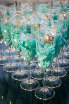 """Classy party favors... lindt chocolates in champagne glasses? perfect. - maybe get engraved """"sisterhood is forever"""" on the bottom?"""