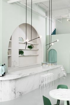 The green-toned interior design of the Budapest Café in Chengdu, China, by Biasol Studio is inspired by the style of director Wes Anderson. Grand Hotel Budapest, Budapest Cafe, Chengdu, Cafe Interior Design, Home Interior, Interior Architecture, Minimalist Architecture, Scandinavian Interior, Interior Exterior