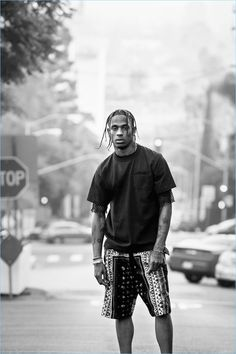 Taking to the streets of California, Travis Scott wears a pocket tee, mesh t-shirt, and printed shorts by Sacai.
