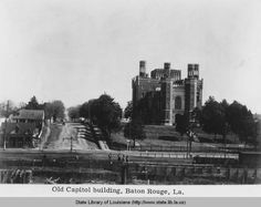 1890s view from the levee of the Old State Capitol and grounds in Baton Rouge Louisiana. / State Library of Louisiana.