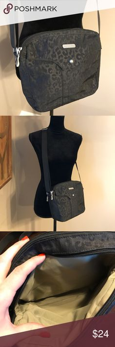 Baggallini Black Printed Crossover Bag!! This brand is known for creating great travel bags that are stylish & functional. This bag looks brand new and is so great. The print subtle but chic. Baggallini Bags Crossbody Bags