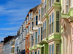enchantedengland:       Aberystwyth, colloquially known as Aber, is located on the western coast of Wales in the county Ceredigion- a former kingdom created as Cardiganshire in 1282. These are some of the lovely houses on the seaside promenade, where ladies in cardies carrying parasols glide about looking self-important. (image by David Glaves on flickr)
