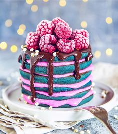 Blue Pancakes With Raspberry Soy Yogurt Melted Chocolate Puffed Millet Topped With Frozen Raspberries . Beautiful Desserts, Cute Desserts, Delicious Desserts, Dessert Recipes, Yummy Food, Crepe Suzette, Pancake Stack, Melting Chocolate, Chocolate Pastry