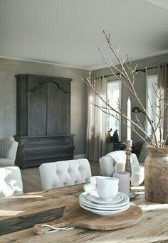 Dining room, white chairs, rustic table, grey tones