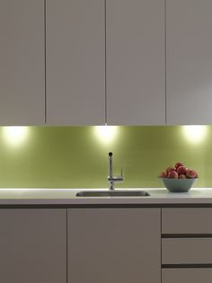 Green glass splashback in Roundhouse kitchen