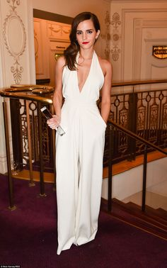 2014 British Fashion Awards - As if by magic: Emma Watson whipped off her jacket to reveal her sexy cream gown which trailed to the floor