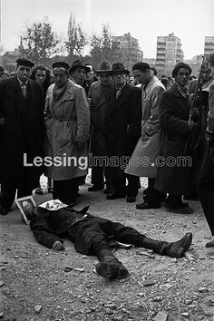 The Hungarian Revolution began with a first mass-rally in Budapest on October 23,1956.It was crushed by Soviet troops after days of street-fighting.A dead AVO-man, killed during the storming of the Headquarters of the Communist Hungarian Workers' Party, is decked out with a picture of Rakosi.