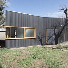 Australian firm Open Studio have completed a small artists' studio shared between two properties in Flemington, Australia. Called Artist Studio, the building contains a studio, store room, garden shed and a garage. It is located between two residences whose occupants removed their boundary fence to create a larger, shared garden. The studio is clad in