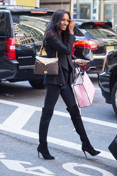 From her over-the-knee boots to her structured blazer, model Jasmine Tookes's look was a superhot spin on w...