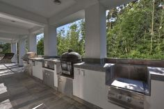 "OUTDOOR KITCHEN Amazing chef's line to prepare for any dining pleasures. Features stainless grill, 2 burners, large tapenyaki grill/griddle, Primo ""Egg"", large low burner for crawfish boils   dishwasher, full sized refrigerator & icemaker."