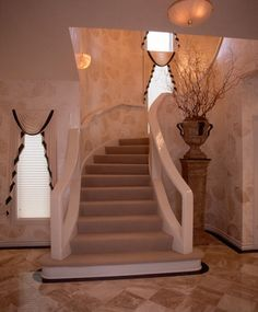 The double bull-nosed base step supports the flared entry to the path that narrows as you reach the middle treads – a nod to a grand staircase with a more eclectic feel.