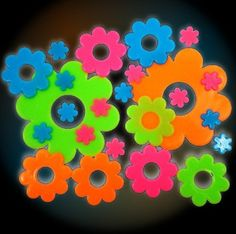 Flowers Glow in the Dark Wall Decorations (24 pack): http://www.amazon.com/Psychedelic-Flowers-Glow-Dark-Decorations/dp/B0043FYAJK/?tag=greavidesto05-20
