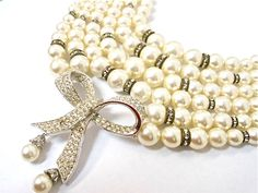 Vintage Bridal Pearl Pave Rhinestone Multi Strand Necklace Bow Statement Wedding Jewelry - EA151. $24.00, via Etsy.